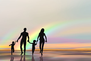 family in front of rainbow